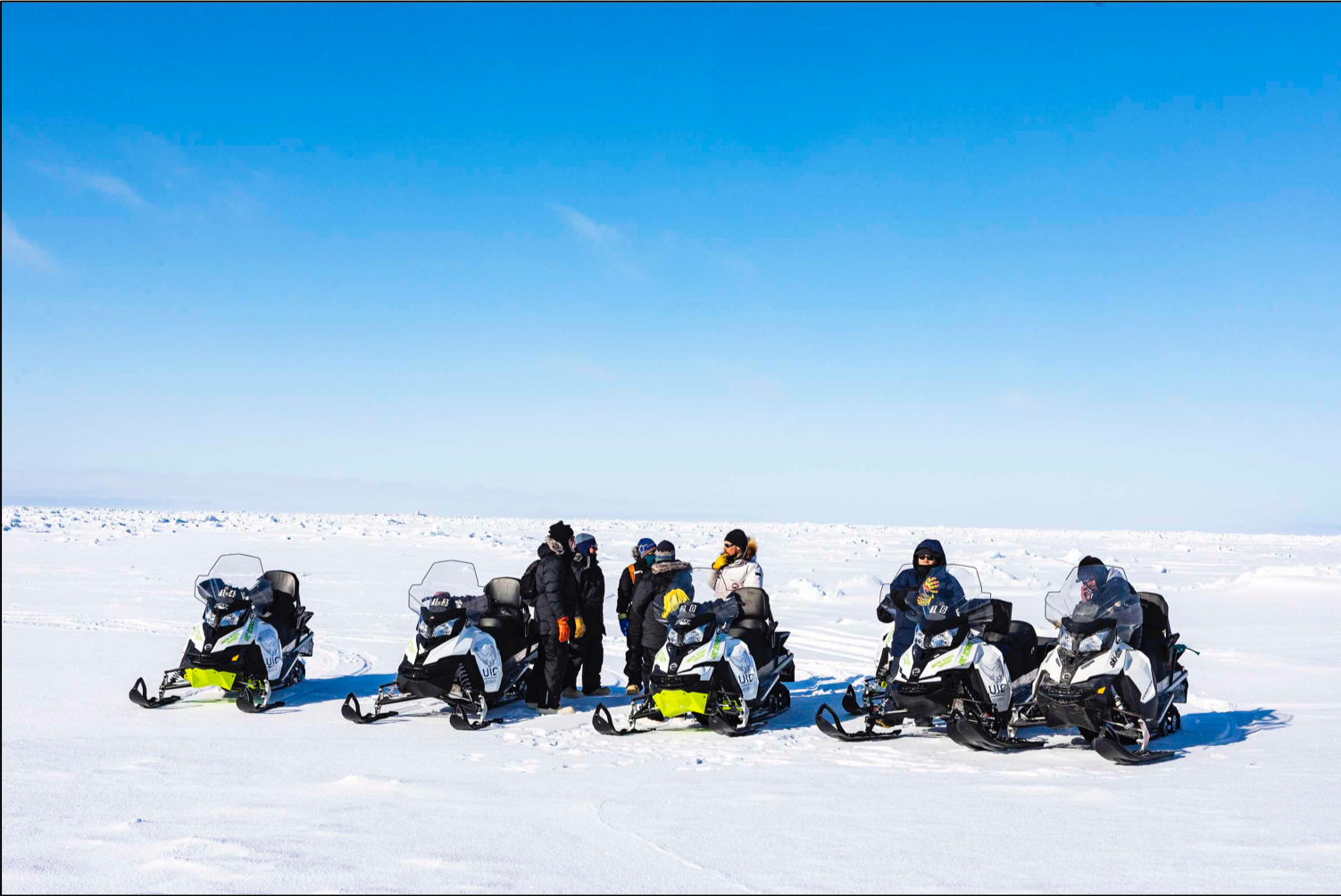 Scientists on snowmobiles
