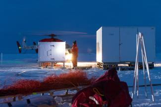 scientists and equipment on ice