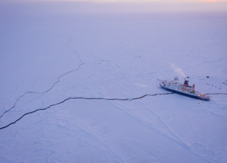 Ship sitting on long crack on the ice