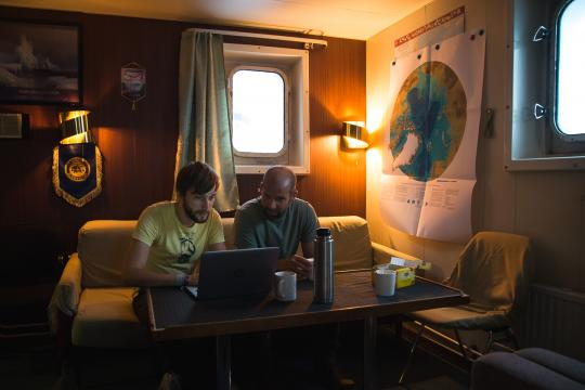 two researchers discussing weather on the Akademic Federov icebreaker